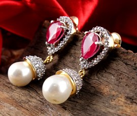 Vogue Crafts & Designs Pvt. Ltd. manufactures and exports imitation jewelry earrings at wholesale prices