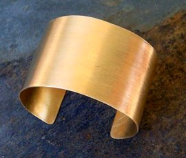 Vogue Crafts & Designs Pvt. Ltd. manufactures and exports metal jewelry cuffs at wholesale prices