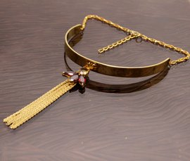 Vogue Crafts & Designs Pvt. Ltd. manufactures and exports metal jewelry necklaces at wholesale prices