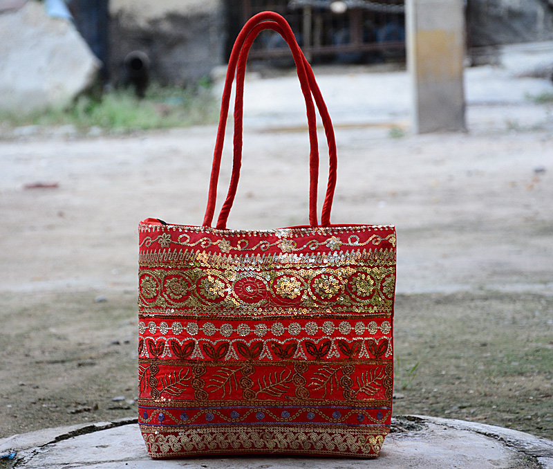 Vogue Crafts & Designs Pvt. Ltd. manufactures Embroidered Red Bag at wholesale price.
