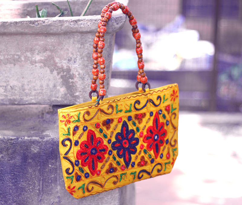 Vogue Crafts & Designs Pvt. Ltd. manufactures Mustard Yellow Bag at wholesale price.