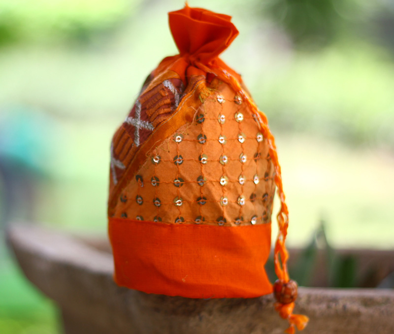 Vogue Crafts & Designs Pvt. Ltd. manufactures Orange Potli Bag at wholesale price.