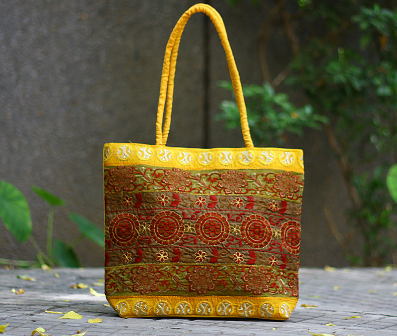 Vogue Crafts & Designs Pvt. Ltd. manufactures Yellow Embroidered Bag at wholesale price.