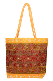 Vogue Crafts and Designs Pvt. Ltd. manufactures Yellow Embroidered Bag at wholesale price.