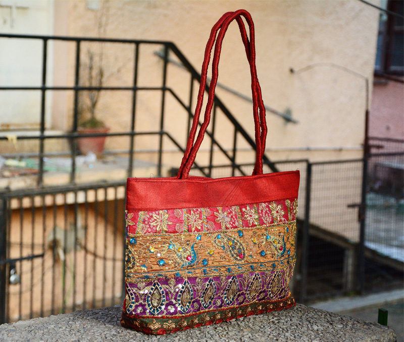 Vogue Crafts & Designs Pvt. Ltd. manufactures Maroon Floral Embroidery Bag at wholesale price.