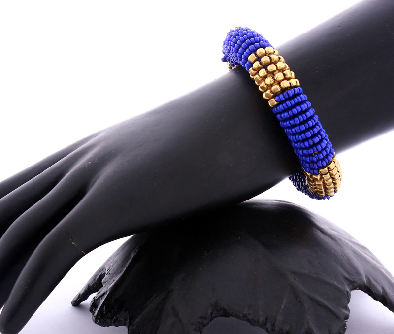 Vogue Crafts & Designs Pvt. Ltd. manufactures Blue Coiled Bracelet at wholesale price.