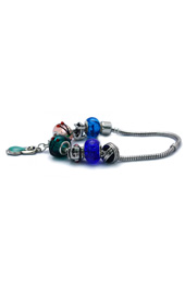 Vogue Crafts and Designs Pvt. Ltd. manufactures Dog Charm Bracelet at wholesale price.