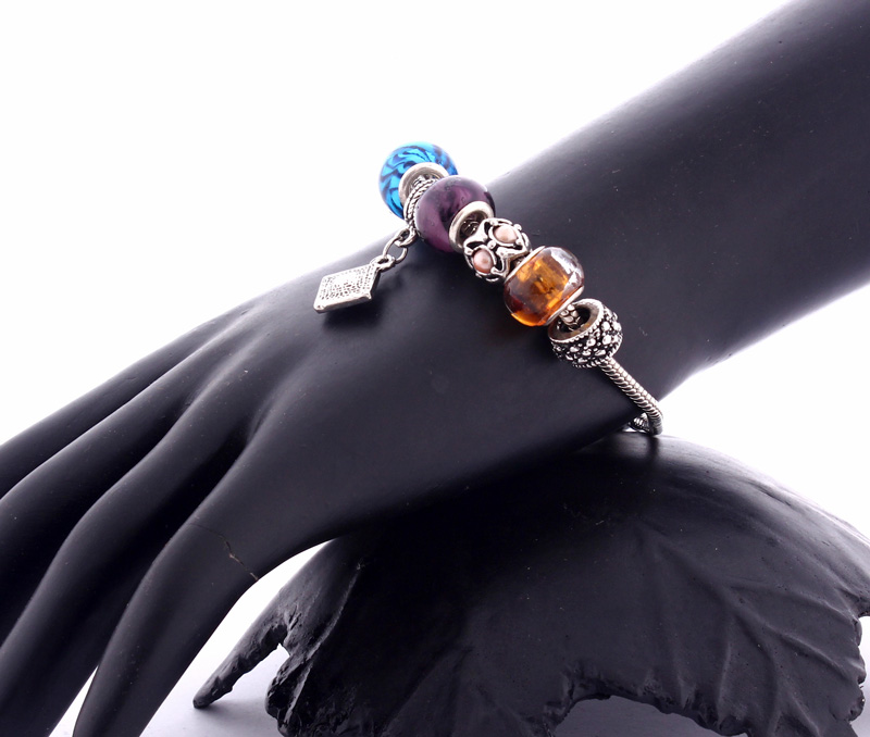 Vogue Crafts & Designs Pvt. Ltd. manufactures Diamond Shape Charm Bracelet at wholesale price.