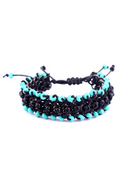 Vogue Crafts and Designs Pvt. Ltd. manufactures Surrounded by Teal Bracelet at wholesale price.