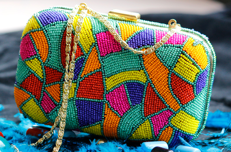 Vogue Crafts & Designs Pvt. Ltd. manufactures Colors of Happiness Clutch at wholesale price.