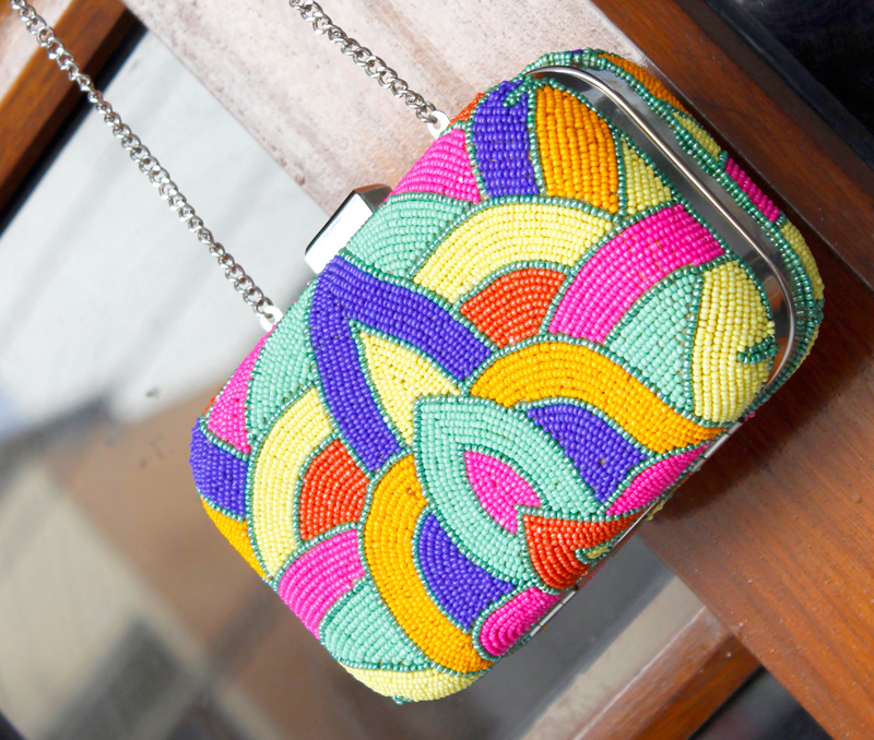 Vogue Crafts & Designs Pvt. Ltd. manufactures Beads and Colors Clutch at wholesale price.
