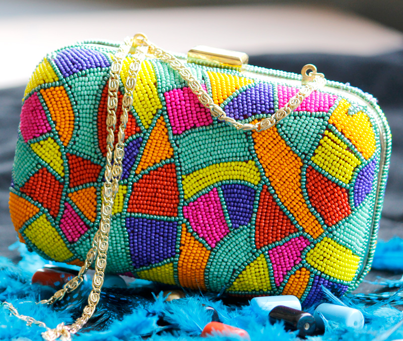 Vogue Crafts & Designs Pvt. Ltd. manufactures Colors and Beads Clutch at wholesale price.