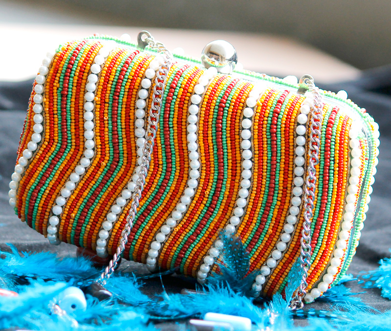 Vogue Crafts & Designs Pvt. Ltd. manufactures Colorful Waves Box Clutch at wholesale price.