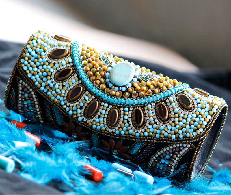 Vogue Crafts & Designs Pvt. Ltd. manufactures Beads and Flowers Clutch at wholesale price.