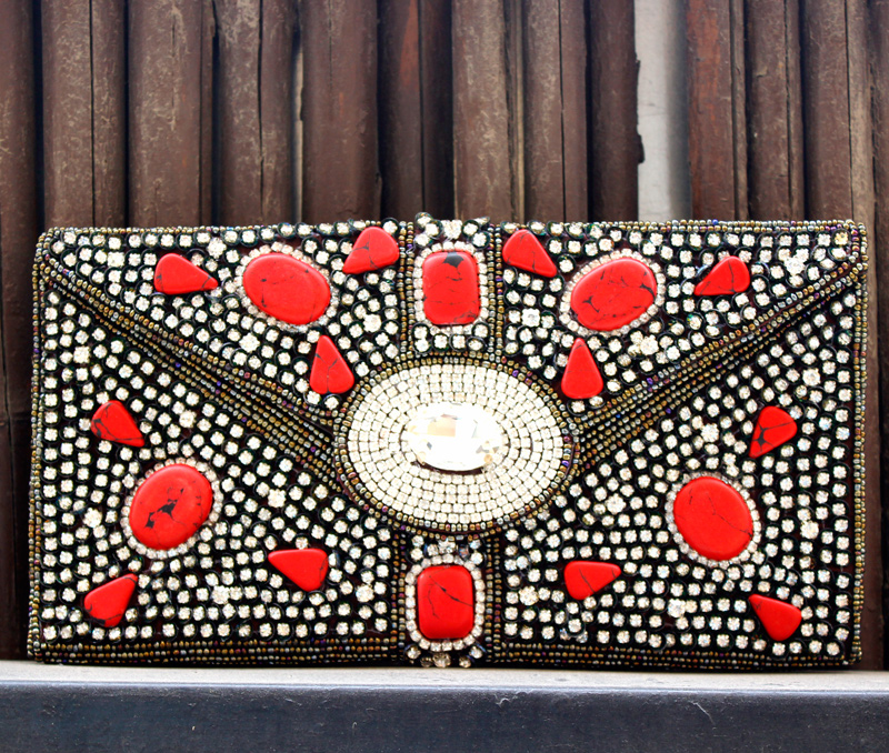 Vogue Crafts & Designs Pvt. Ltd. manufactures Dots of Red Envelope Clutch at wholesale price.