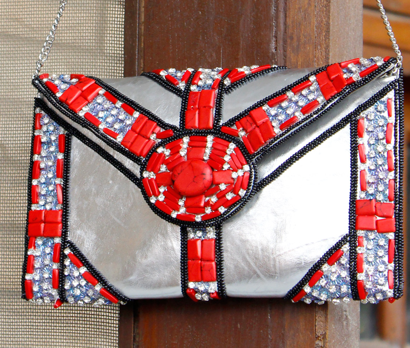 Vogue Crafts & Designs Pvt. Ltd. manufactures Dose of Red Envelope Clutch at wholesale price.
