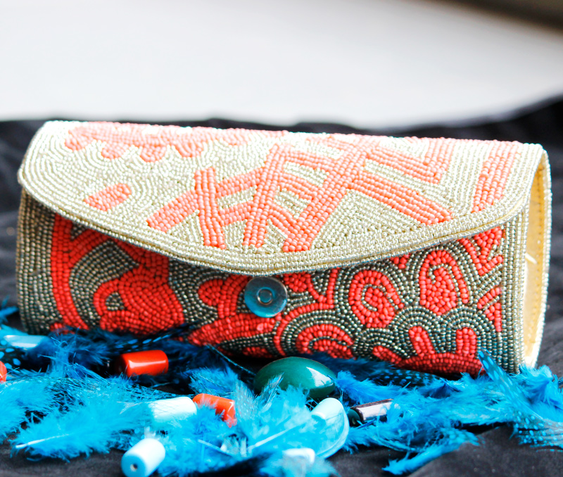 Vogue Crafts & Designs Pvt. Ltd. manufactures Gold and Neon Clutch at wholesale price.