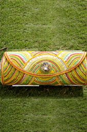 Vogue Crafts and Designs Pvt. Ltd. manufactures The Rangoli Clutch at wholesale price.
