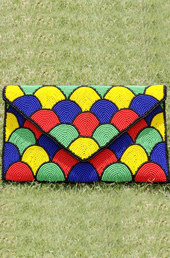 Vogue Crafts and Designs Pvt. Ltd. manufactures The Colored Eggs Clutch at wholesale price.