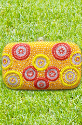 Vogue Crafts and Designs Pvt. Ltd. manufactures The Sunny Morning Clutch at wholesale price.