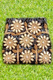Vogue Crafts and Designs Pvt. Ltd. manufactures Black Sunflower Clutch at wholesale price.