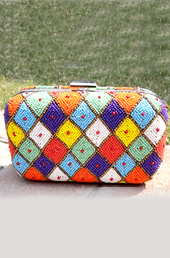 Vogue Crafts and Designs Pvt. Ltd. manufactures Kite Pattern Clutch at wholesale price.