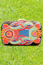 Vogue Crafts and Designs Pvt. Ltd. manufactures Splash of Colors Clutch at wholesale price.