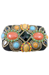 Vogue Crafts and Designs Pvt. Ltd. manufactures The Embossed-Stones Clutch at wholesale price.