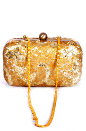 Vogue Crafts and Designs Pvt. Ltd. manufactures Sequined Flowers Clutch at wholesale price.