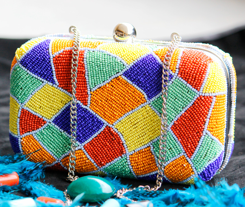 Vogue Crafts & Designs Pvt. Ltd. manufactures Colors of Love Box Clutch at wholesale price.