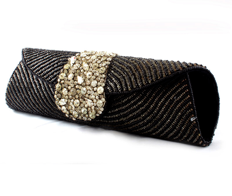 Vogue Crafts & Designs Pvt. Ltd. manufactures Dots of Black and Silver Clutch at wholesale price.