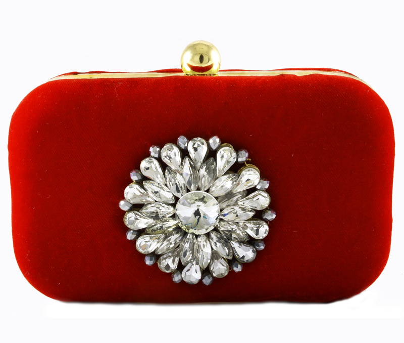 Vogue Crafts & Designs Pvt. Ltd. manufactures Red Broach Box Clutch at wholesale price.