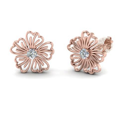 Vogue Crafts and Designs Pvt. Ltd. manufactures Rose Gold Flower Stud Earrings at wholesale price.