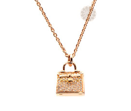 Vogue Crafts and Designs Pvt. Ltd. manufactures Diamond and Gold Purse Pendant at wholesale price.