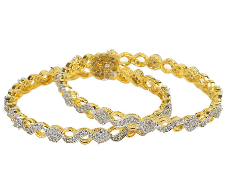 Vogue Crafts & Designs Pvt. Ltd. manufactures Designer Gold and Diamond Pair of Bangles at wholesale price.