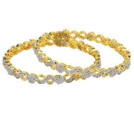 Vogue Crafts and Designs Pvt. Ltd. manufactures Designer Gold and Diamond Pair of Bangles at wholesale price.