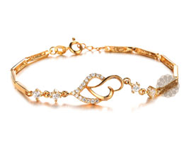 Vogue Crafts and Designs Pvt. Ltd. manufactures Diamond and Gold Heart Bracelet at wholesale price.