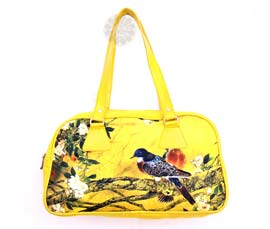 Vogue Crafts and Designs Pvt. Ltd. manufactures Bird Print Yellow Handbag at wholesale price.