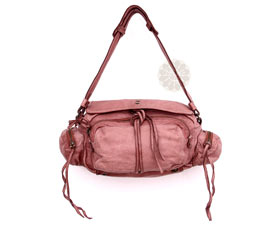 Vogue Crafts and Designs Pvt. Ltd. manufactures Fancy Pink String Handbag at wholesale price.