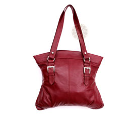 Vogue Crafts and Designs Pvt. Ltd. manufactures Ladies Maroon Handbag at wholesale price.