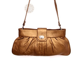 Vogue Crafts and Designs Pvt. Ltd. manufactures Popular Golden Sling Bag at wholesale price.