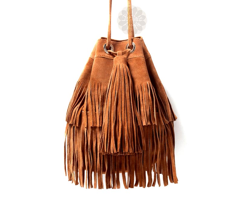 Vogue Crafts & Designs Pvt. Ltd. manufactures Brown Drawstring Fringe Bag at wholesale price.