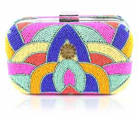 Vogue Crafts and Designs Pvt. Ltd. manufactures Fancy Multicolor Clutch at wholesale price.