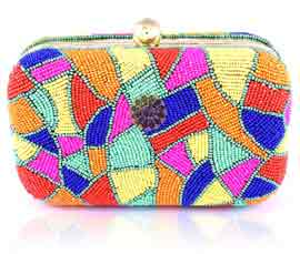 Vogue Crafts and Designs Pvt. Ltd. manufactures Multicolor Magnetic Closure Clutch at wholesale price.