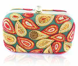 Vogue Crafts and Designs Pvt. Ltd. manufactures Multicolor Embroidered Clutch at wholesale price.