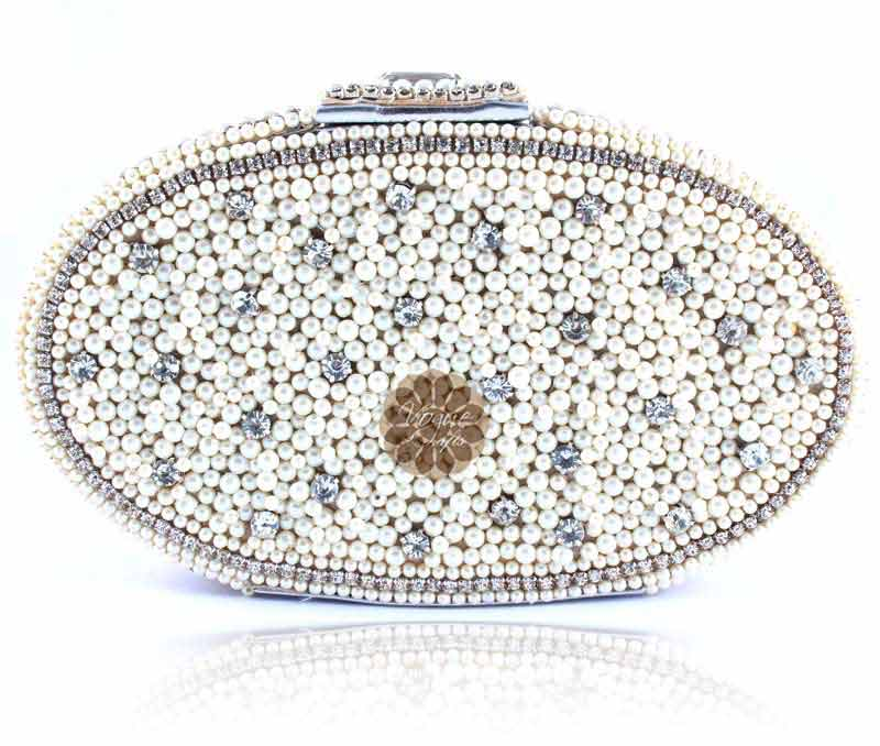Vogue Crafts & Designs Pvt. Ltd. manufactures Divine Oval Pearl Clutch at wholesale price.