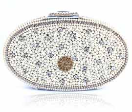 Vogue Crafts and Designs Pvt. Ltd. manufactures Divine Oval Pearl Clutch at wholesale price.