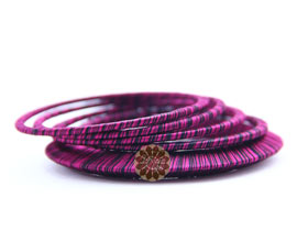 Vogue Crafts and Designs Pvt. Ltd. manufactures Stack of Purple Bangles at wholesale price.