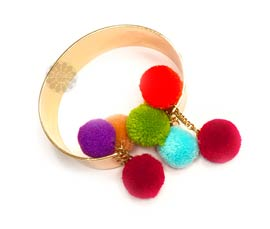Vogue Crafts and Designs Pvt. Ltd. manufactures Trendy Pom Pom Bracelet at wholesale price.