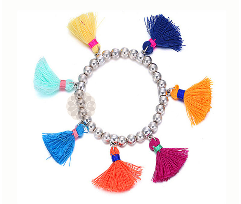 Vogue Crafts & Designs Pvt. Ltd. manufactures Multicolor Tassels Bracelet at wholesale price.